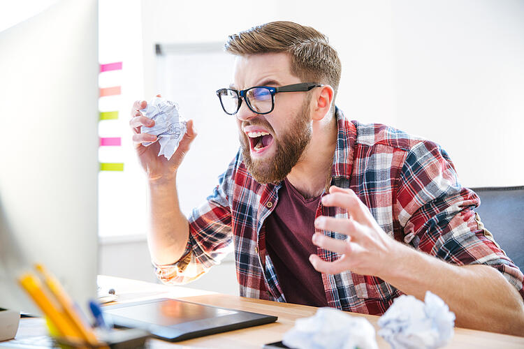 Redesign a Website   Don't Index Test Site   Angry worker at desk