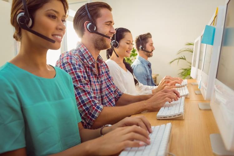 HubSpot vs. Pardot | Customer Service | Representatives at call center wearing headsets