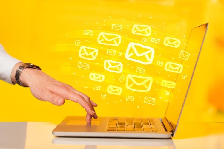 HubSpot vs. Pardot | Campaigns | Sending emails on laptop
