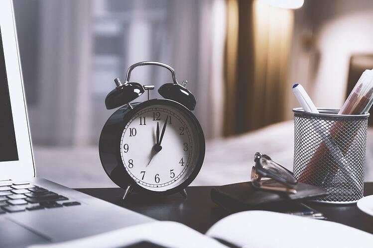 Keep in mind - website redesign projects take time - clock on desk