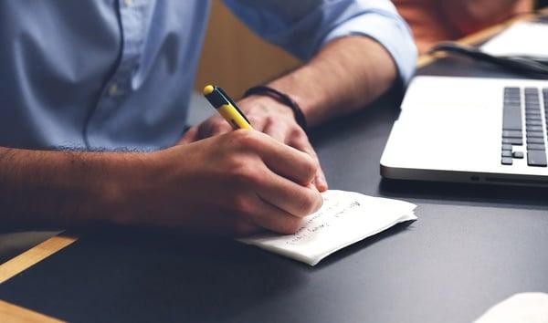 Business man writing | marketing plan pitfalls